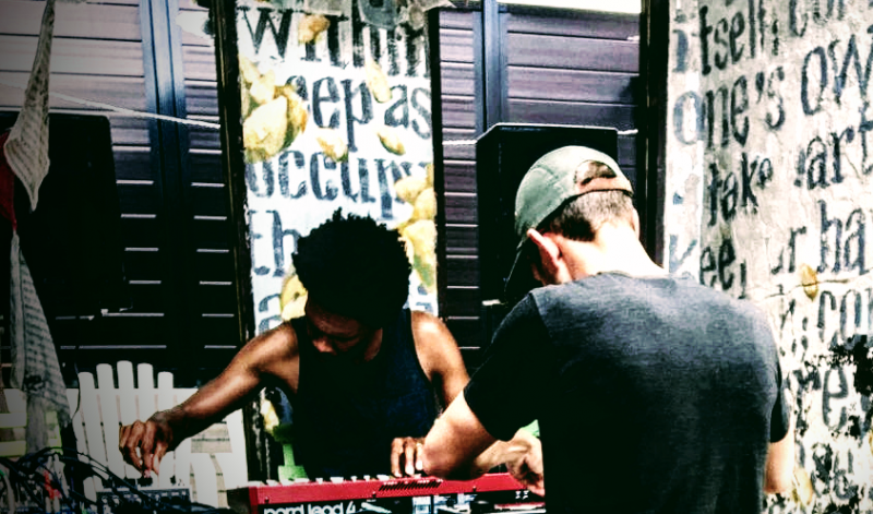 two musicians playing electronic instruments