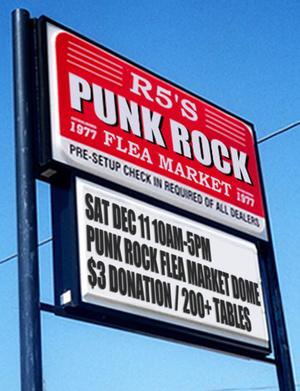 A sign for the Punk Rock Flea Market